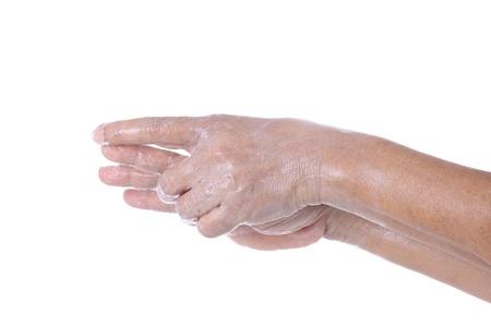 moisturiser: Wrinkled female hands applying moisturiser