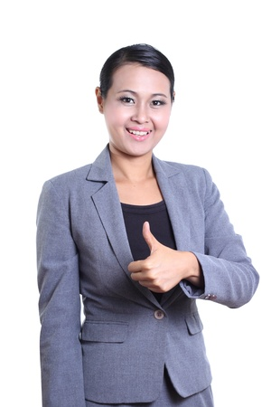 Business woman giving the thumb up