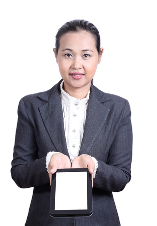 Business woman presenting Digital Tablet Stock Photo
