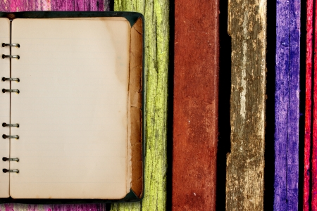 old book  with multicolored wooden background