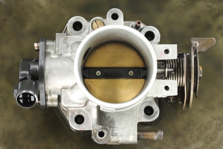 Cleaning carburetor with gasoline Stock Photo