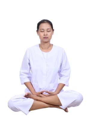 Beautiful  woman meditating  with eyes closed. Stock Photo