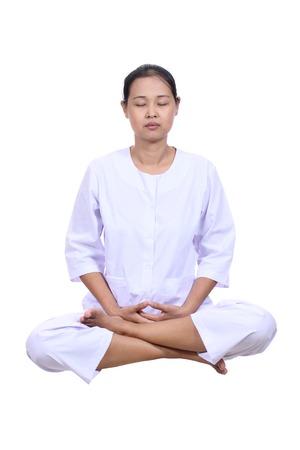 Beautiful  woman meditating  with eyes closed. Stock Photo