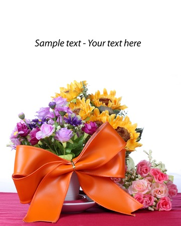 Big ribbon with colorful artificial flower photo