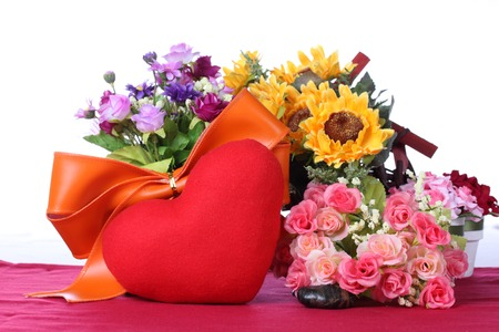 Red heart with colorful artificial flower photo