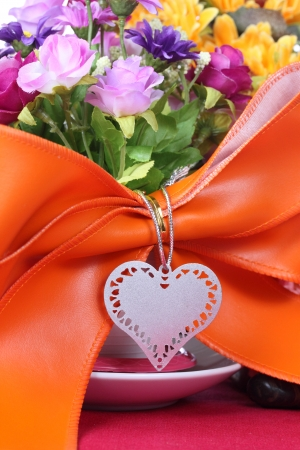 Blank tag with colorful artificial flower photo