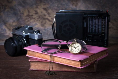 old watch: Group of objects on wood table. old watch, retro radio, camera, books, Still life Stock Photo