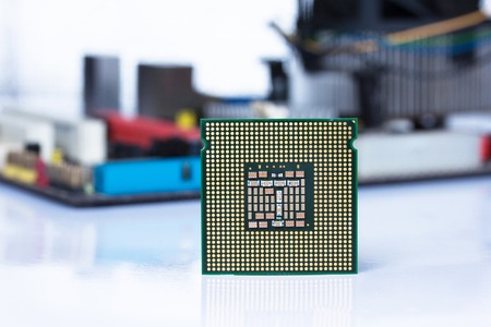 Old processor and printed computer motherboard photo