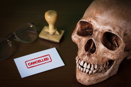 CANCELLED red rubber stamp and human skull