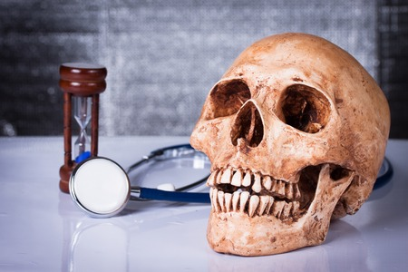 Medical concept, weathered human skull and stethoscope