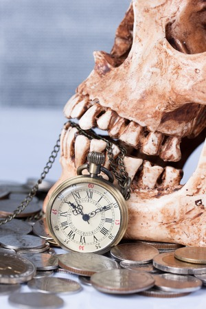 Pocket wach and human skull ,concept and idea photo