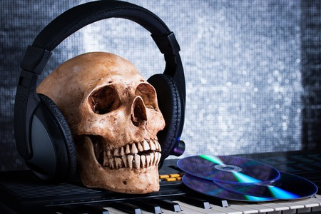 Human skull with earphones, still life photo