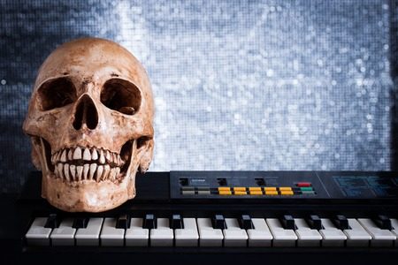 Human skull with keyboard, still life photo