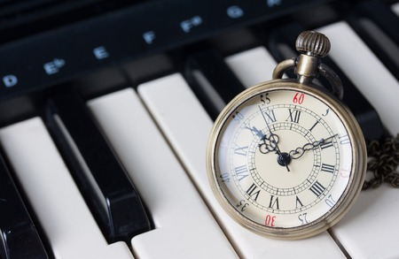 Pocket watch on keyboard photo