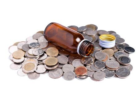 Medcine bottle with coins, Medical concept
