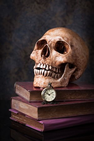 Pocket  watch and human skull ,concept and idea