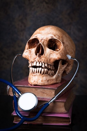 Medical concept ,Stethoscope and human skull photo