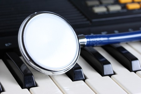 Stethoscope on keyboard ,music therapy Stock Photo