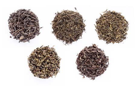 assortment of dry tea, isolated on white background photo