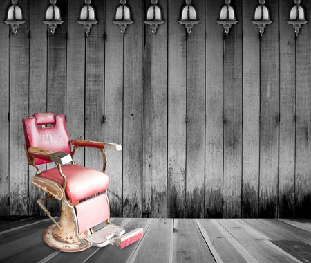 Antique barber chair in room photo