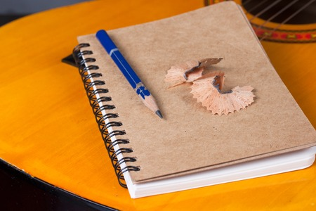 Diary and a used pencil  with classical guitar background