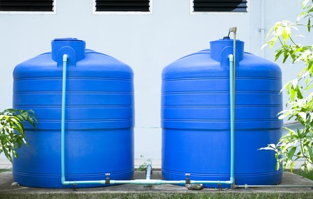 tanks: Plastic water tank Stock Photo