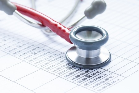 Stethoscope and time sheet
