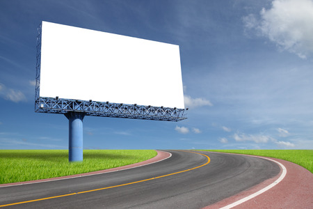 Blank billboard on blue sky with highway