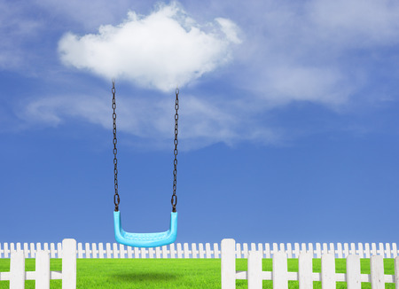 Children swing in the park with blue sky Stock Photo