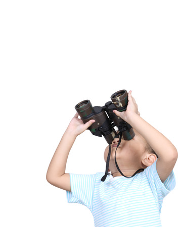 Boy using binoculars looking something, isolated on white background, Learning concept. Stock Photo