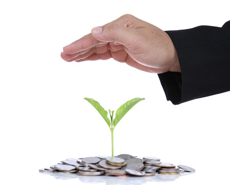 safe investment: Businessman hand protect money for safe investment in the future. Stock Photo