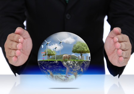 protect earth: Businessman hand protect earth, globe concept. (Elements of this image furnished by NASA)