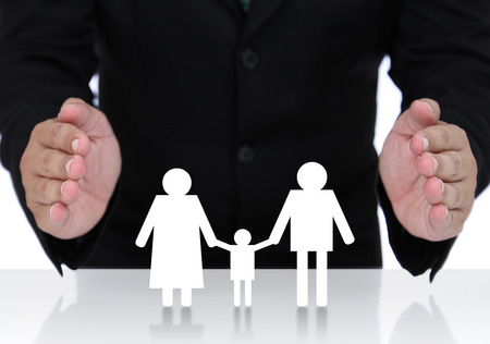 protect family: Businessman hand protect  family