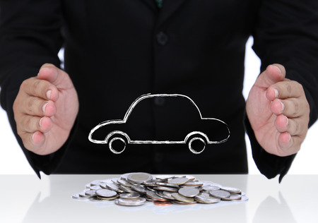 Car insurance with businessman hand and coins Stock Photo