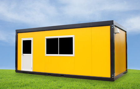 Yellow container office with door and window with blue sky photo