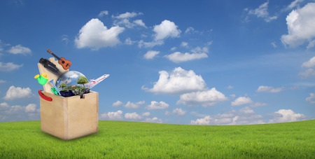 crafted: Wooden toys box on hill and blue sky with clouds in the background.(Elements of this image furnished by NASA)