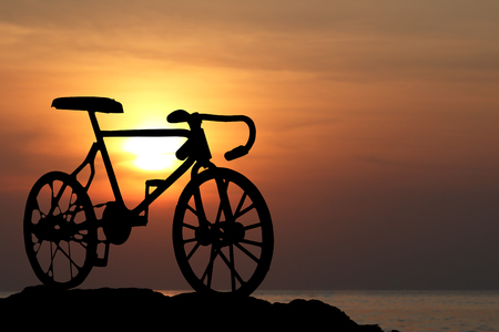 Silhouette of a bike at orange sunset