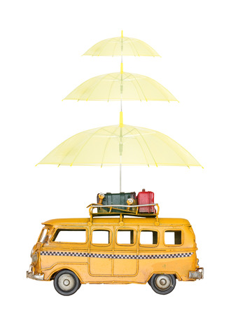 Miniature car with umbrella, isolated on white background