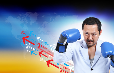 businessman with boxing glove ready to fight, business concept 版權商用圖片