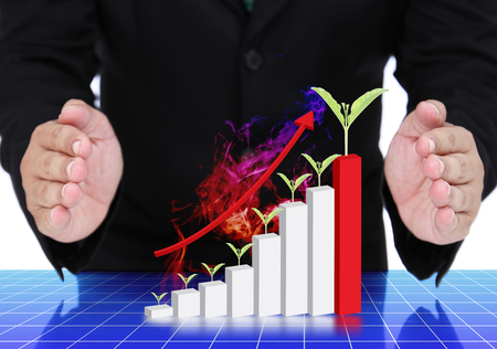 businessman protecting growth graph