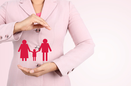 business woman hand protect family, isolated on white background Stock Photo