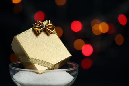 Gold gift box with bokeh background