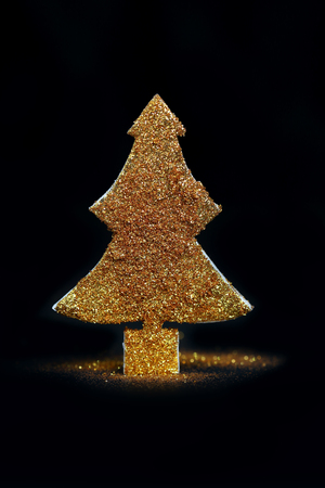 Sparkling gold glitter christmas tree with bokeh background Stock Photo
