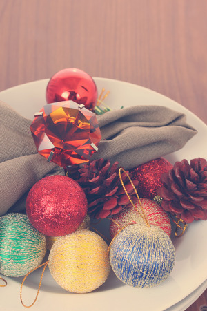 Christmas decorations in white bowl.