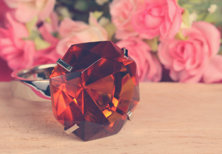 topaz ring on wood with colorful artificial flower Standard-Bild