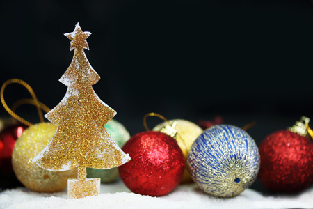 Sparkling gold glitter christmas tree with black background