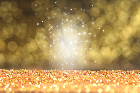 Abstract gold glitter background, defocused