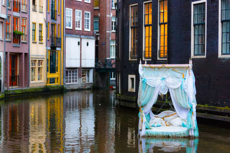 four poster bed: Turquoise four-poster bed floating on the water in Amsterdam, Holland