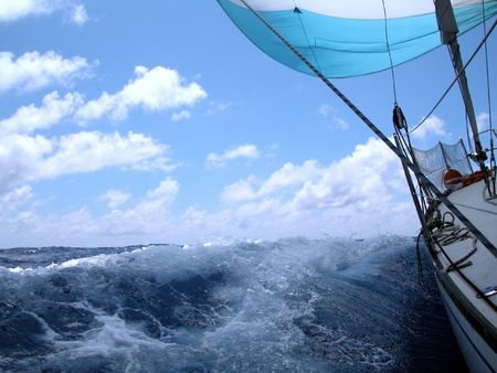 Sailing with wind in the ocean Stock Photo