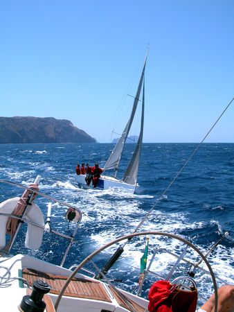sailing in regatta with strong wind in a summer day